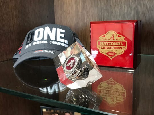 Louisiana head coach Billy Napier's mementos including his Alabama national championship ring in his office in Lafayette. La.