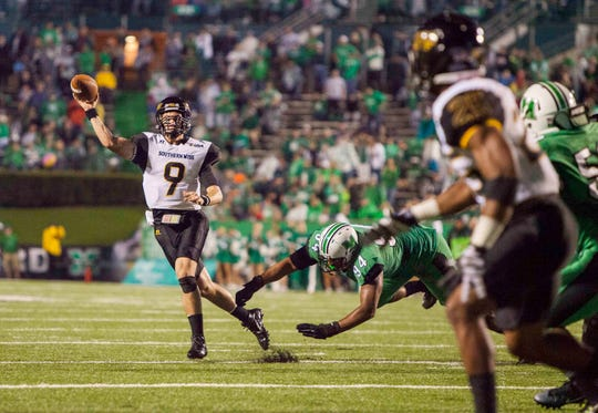 Southern Miss quarterback Nick Mullens (9) attempts to throw to the end zone against Marshall on Oct. 9, 2015, in Huntington, WV.