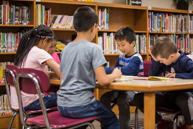 Students work in the library at North View Elementary on Wednesday. Muncie Community Schools released that the enrollment for this school year was only down 46 students from a year ago.