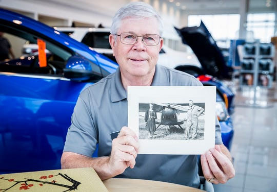 Rodney Huffman looks through family photos depicting his great aunt and uncle Otto and Mabel Huffman at the American Chevrolet Dealership in Muncie Wednesday morning.