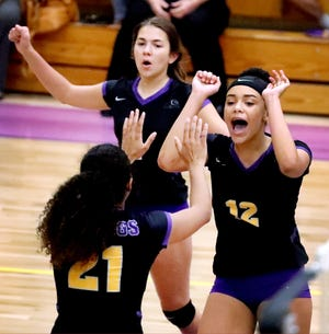 Smyrna's Avery Petrilli (1), Madison Boyd (12) and Janvier Buggs (21) celebrate a point against La Vergne on Tuesday.