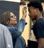 Felicia Garland, left, fixes son Darius Garland's hair before he was interviewed during Vanderbilt's first day of open basketball practice Sept. 26, 2018.