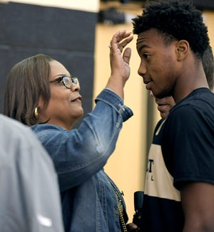 Felicia Garland, left, fixes her son's, Darius Garland, hair before he was being interviewed by the media during Vanderbilt's first day of open basketball practice on Wednesday, Sept. 26, 2018.