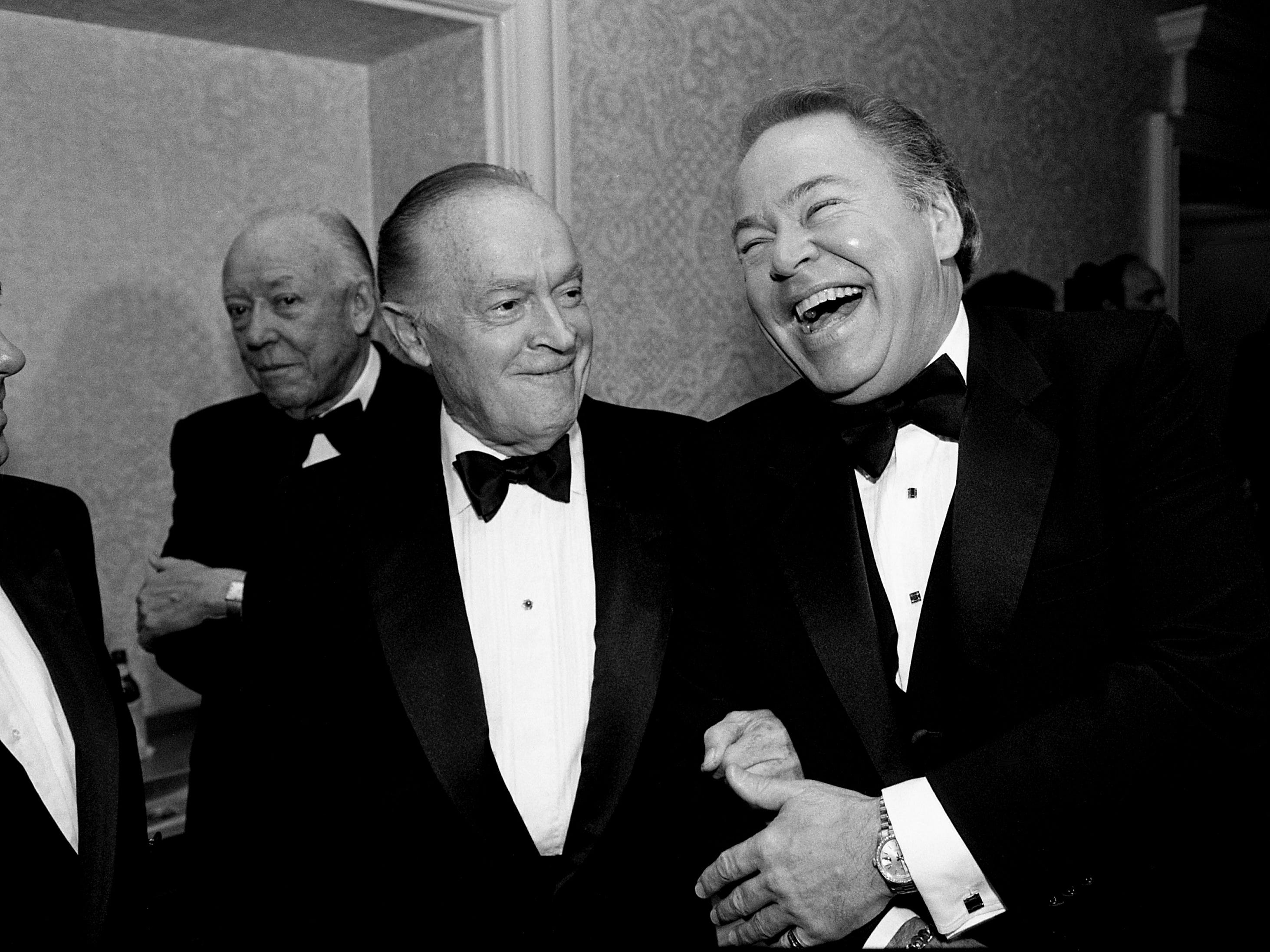 "Bob Hope, left, shares a joke with his friend Roy Clark during a reception and dinner in Clark's honor, ""A Salute to Roy Clark,"" in the Plantation Ballroom of the Sheraton Music City on Sept. 9, 1988."