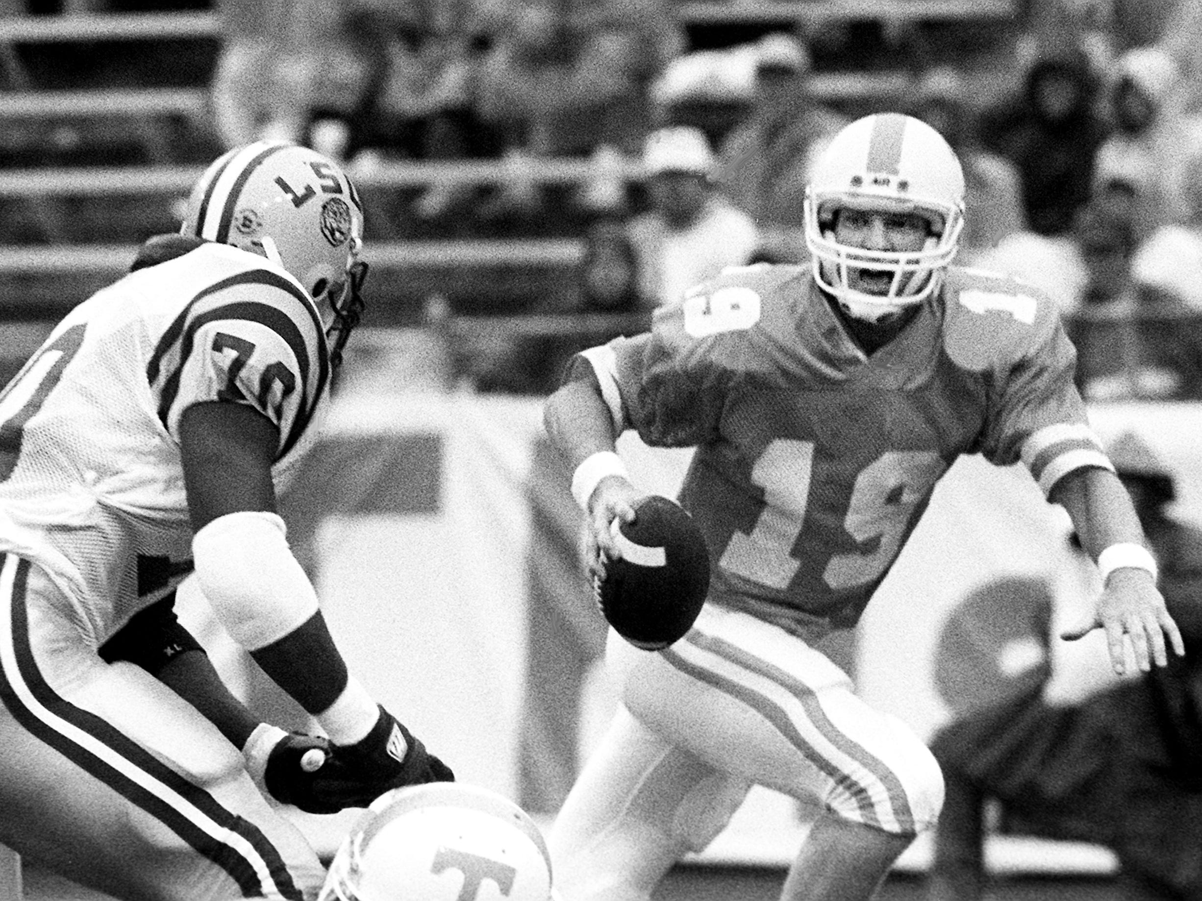 Tennessee senior quarterback Jeff Francis (19) gets pressure from LSU defensive end Clint James (70). Winless Tennessee fall 34-9 to ninth-ranked LSU before 92,849 fans at Neyland Stadium in Knoxville Sept. 17, 1988.