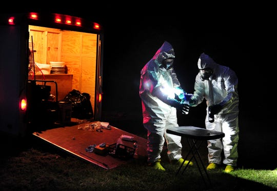 Tennessee law enforcement diffuse a meth lab found in the woods of Obion County in 2013.