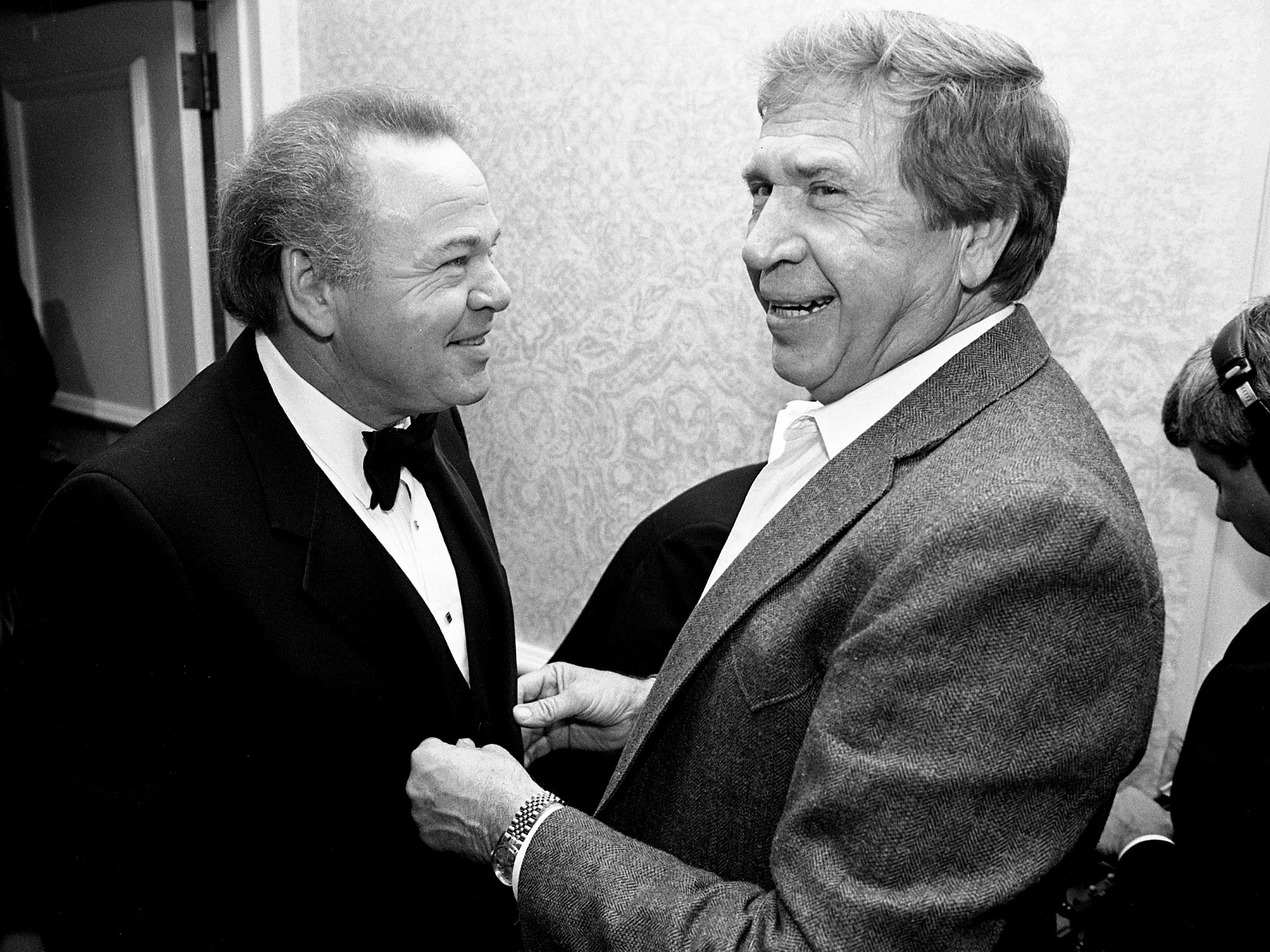"""Hee Haw"" co-host Roy Clark, left, and Buck Owens laugh during a reception and dinner in Clark's honor, ""A Salute to Roy Clark,"" in the Plantation Ballroom of the Sheraton Music City on Sept. 9, 1988."