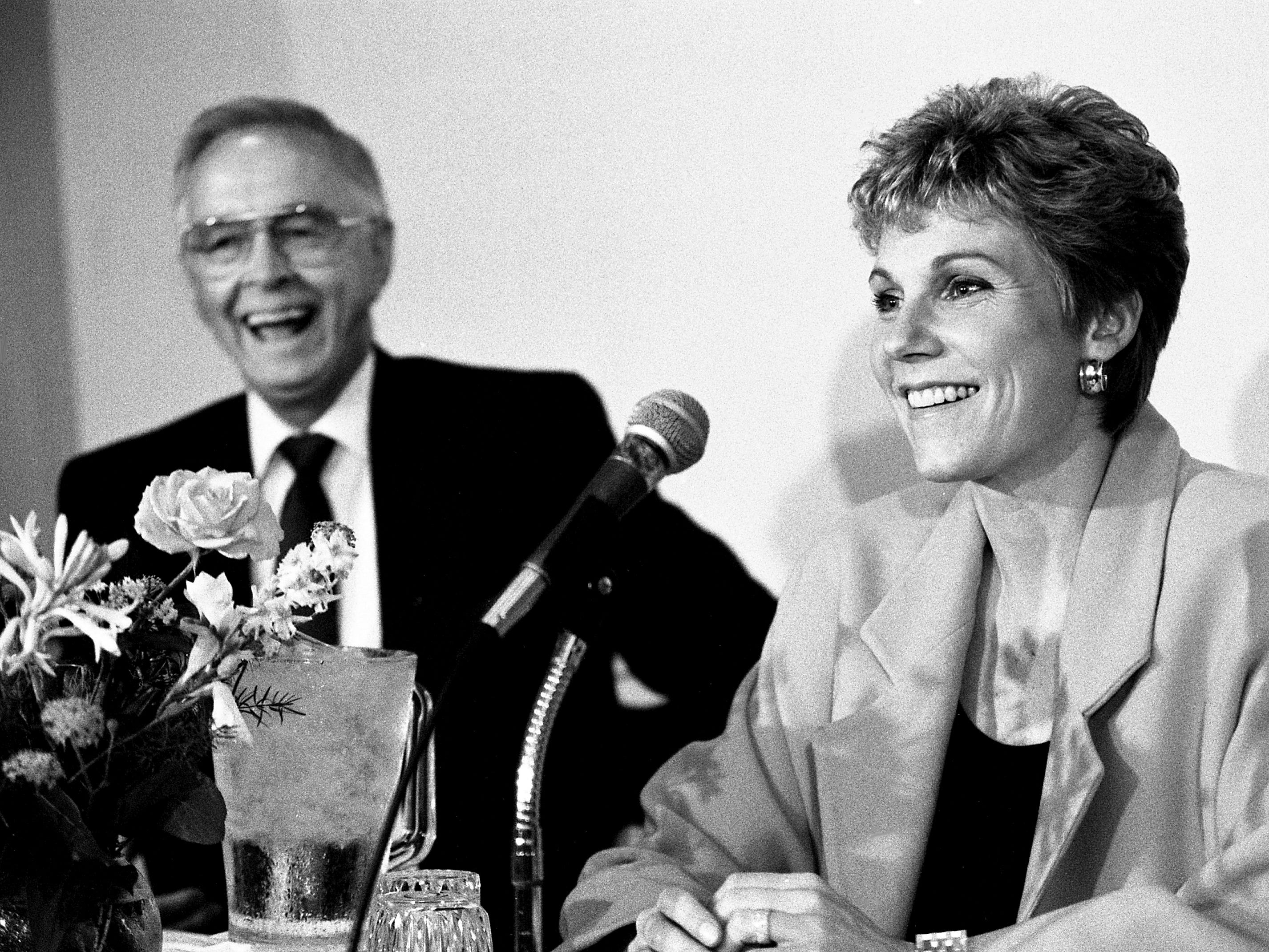 Anne Murray, right, and Capitol Records President Jim Foglesong field questions during a news conference Sept. 21, 1988, at the Vanderbilt Plaza Hotel. They are celebrating Murray's return to Nashville recording for her 20th anniversary with the label and a benefit concert on behalf of the Nashville Songwriters Association International in November.