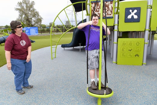 Joy Fishers watches her son, Sam Fisher, plays at the new Mary's Magical Place, an all-inclusive playground in Hendersonville on Tuesday, Sept,.25, 2018. Mary's Magical Place is named for Mary McAuley, a Hendersonville teen who died from complications of cerebral palsy in 2015.