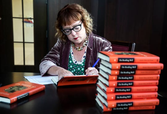 """Karen Swallow Prior signs copies of her book """"On Reading Well: Finding the Good Life through Great Books"""" before speaking at Montgomery Bell Academy on Sept. 25, 2018."""