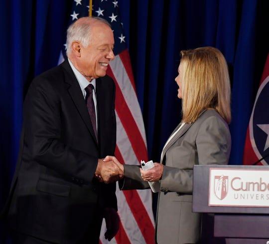 Democrat Phil Bredesen and Republican Marsha Blackburn shake hands after a Senate debate at Cumberland University on Sept. 25, 2018, in Lebanon.
