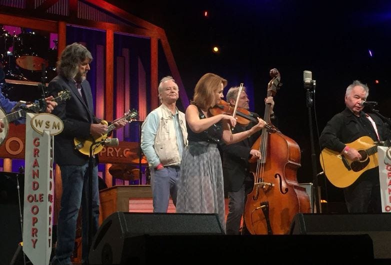 Bill Murray pops up onstage with John Prine and the SteelDrivers at the Grand Ole Opry