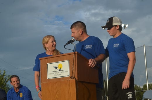 Rachel, Tommy and Griffin McAuley spoke at the grand opening of Mary's Magical Place in honor of Mary McAuley.