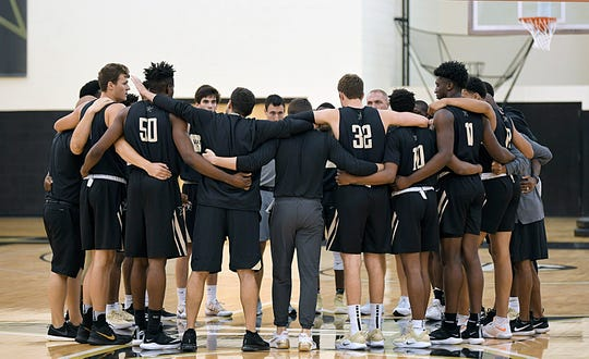Vanderbilt players and coaches join arms in center court during the first day of open basketball practice on Wednesday, Sept. 26, 2018.