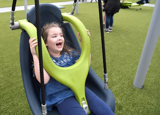Addie Luna,6, laughs while playing at the new Mary's Magical Place, an all-inclusive playground in Hendersonville on Tuesday, Sept. 25, 2018.  Mary's Magical Place is named for Mary McAuley, a Hendersonville teen who died from complications of cerebral palsy in 2015.