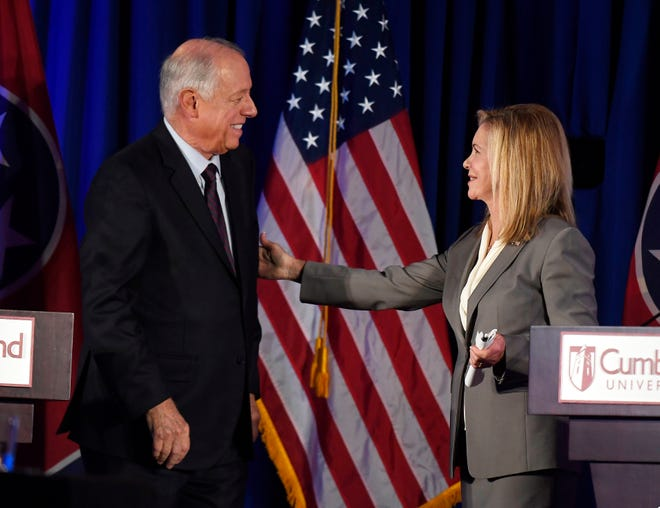 Democrat Phil Bredesen and Republican Marsha Blackburn chat after a debate at Cumberland University in Lebanon on Tuesday, Sept. 25, 2018.