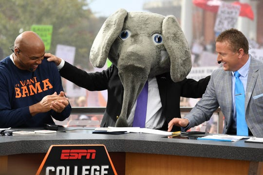 Lee Corso wears the Alabama Crimson Tide mascot head as Charles Barkley and Kirk Herbstreit look on before the game between the Auburn Tigers and the Alabama Crimson Tide at Jordan-Hare Stadium on Nov. 25, 2017.