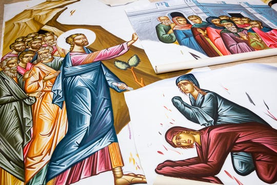 Three panels of canvas, each painted by John Filippakis, overlap each other on the floor to depict the Raising of Lazarus icon that will be added to the sanctuary of St. Paul Orthodox Church in Naples on Wednesday, Sept. 26, 2018.