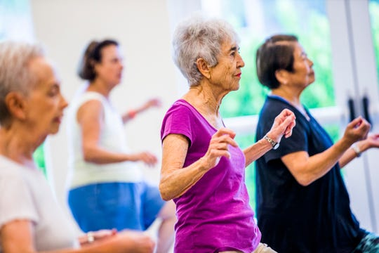 Karen Queenan leads a Zumba class for residents at Vi at Bentley Village in North Naples on Wednesday, Sept. 26, 2018.