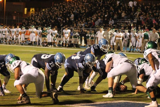 Wayne Valley's Ryan Michels about to score on quarterback sneak. Lineman pictured are Shaquai Anderson (78) and Jordan Botero (54)