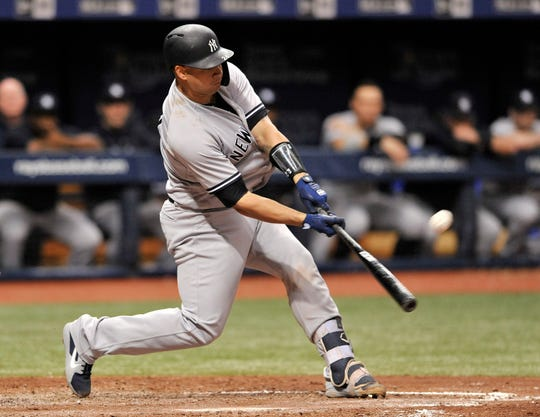 New York Yankees' Gary Sanchez hits a three-run homer off Tampa Bay Rays reliever Jalen Beeks during the third inning of a baseball game Tuesday, Sept. 25, 2018, in St. Petersburg, Fla.