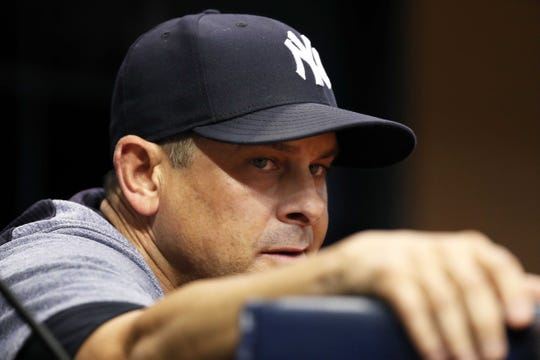 Sep 25, 2018; St. Petersburg, FL, USA; New York Yankees manager Aaron Boone (17) looks on against the Tampa Bay Rays at Tropicana Field.