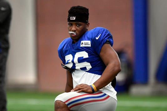 New York Giants running back Saquon Barkley (26) stretches during NFL  practice at the training center in East Rutherford fd0e850b3