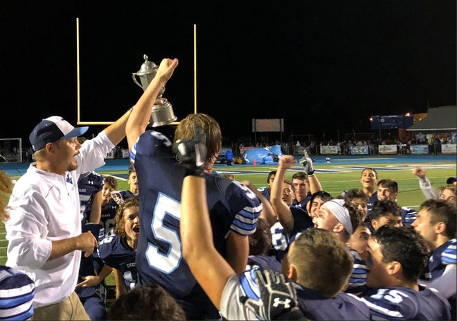 Wayne Valley coach Roger Kotlarz presenting the football team with the TODAY Cup, which is sponsored by Wayne Valley/Passaic Valley Today.