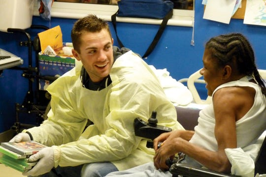 David Wright with a patient at CKHD.