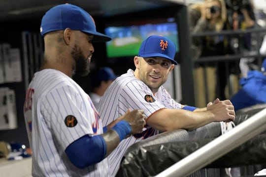 New York Mets' David Wright talks with Jose Reyes, left, during the seventh inning of the team's baseball game against the Atlanta Braves on Tuesday, Sept. 25, 2018, in New York.