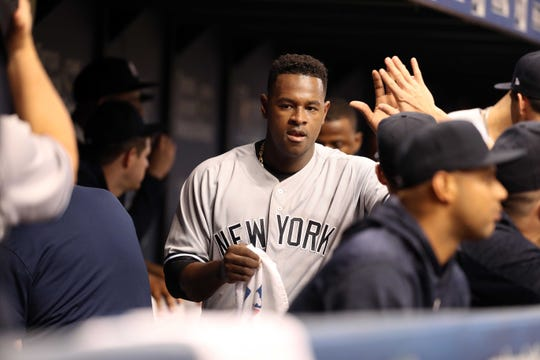 Sep 25, 2018; St. Petersburg, FL, USA; New York Yankees starting pitcher Luis Severino (40) is congratulated in the dugout at the end of the second inning against the Tampa Bay Rays at Tropicana Field.