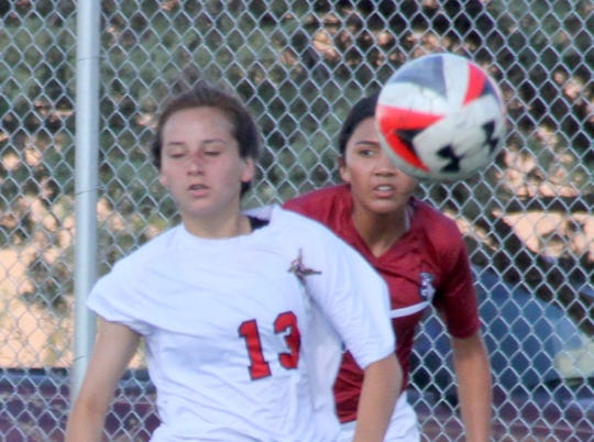 Lady 'Cat junior Anne Marie Magana (background) shadows a Centennial player during Tuesday's District 3-5A match.