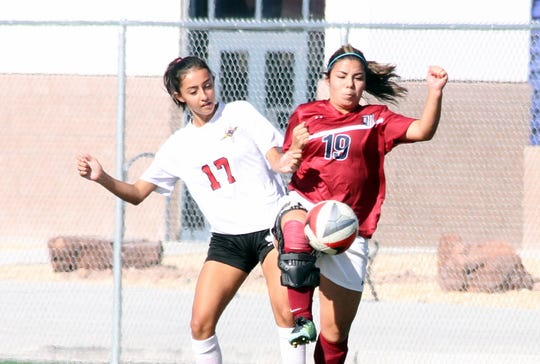 Senior Lady 'Cat Mireya Trujillo (19) takes the ball away from a Centennial High player during Tuesday's 3-0 loss to the Hawks.