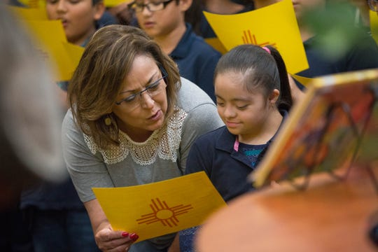 "Susana Martinez, governor of New Mexico, sings ""Los Colores"" with sixth grader Paola Delgado, 10,  along with other six graders students at the  Desert View Elementary School  School Library in Sunland Park, where she joined  the students and staff in celebrating getting A grades from the Public Education Department, Wednesday September 26, 2018."