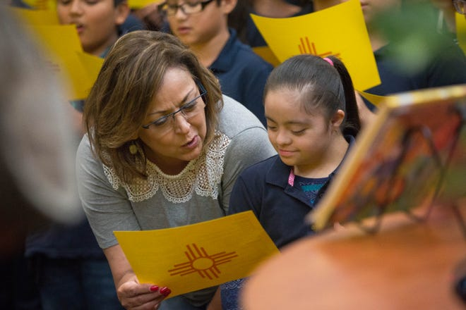 "Gov. Susana Martinez sings ""Los Colores"" with sixth-grader Paola Delgado, 10, along with other sixth-grade students at the Desert Hills Elementary School Library in Sunland Park, where she joined the students and staff in celebrating getting A grades from the Public Education Department, Wednesday September 26, 2018."
