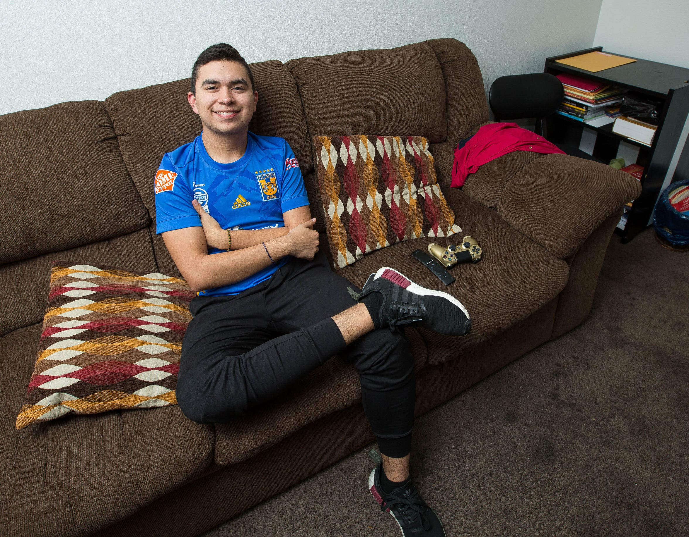 Armando Cantú, a senior at Centennial High School, works 20 hours a week at Bosa Donuts & Burritos and enjoys running the Triviz trail when he's not in school.