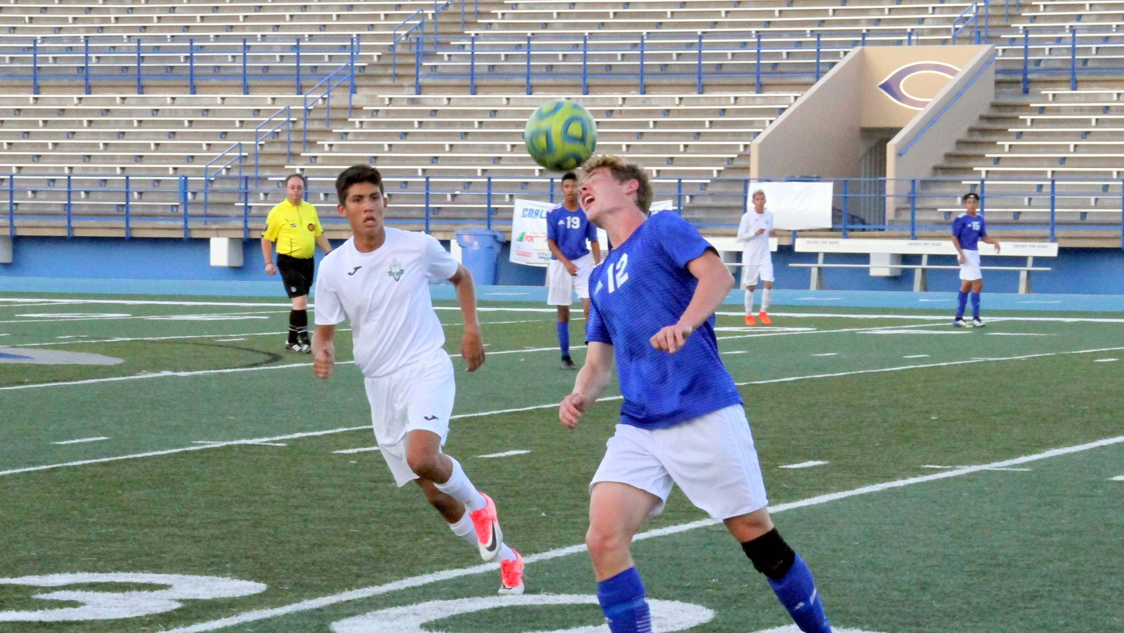 Weston Rhoades heads a ball during the first half of Tuesday's match against Santa Teresa.