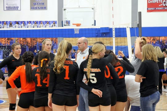 The Artesia Lady Bulldogs talk during a timeout in the second set of Tuesday's match against Carlsbad. Artesia won in straight sets.