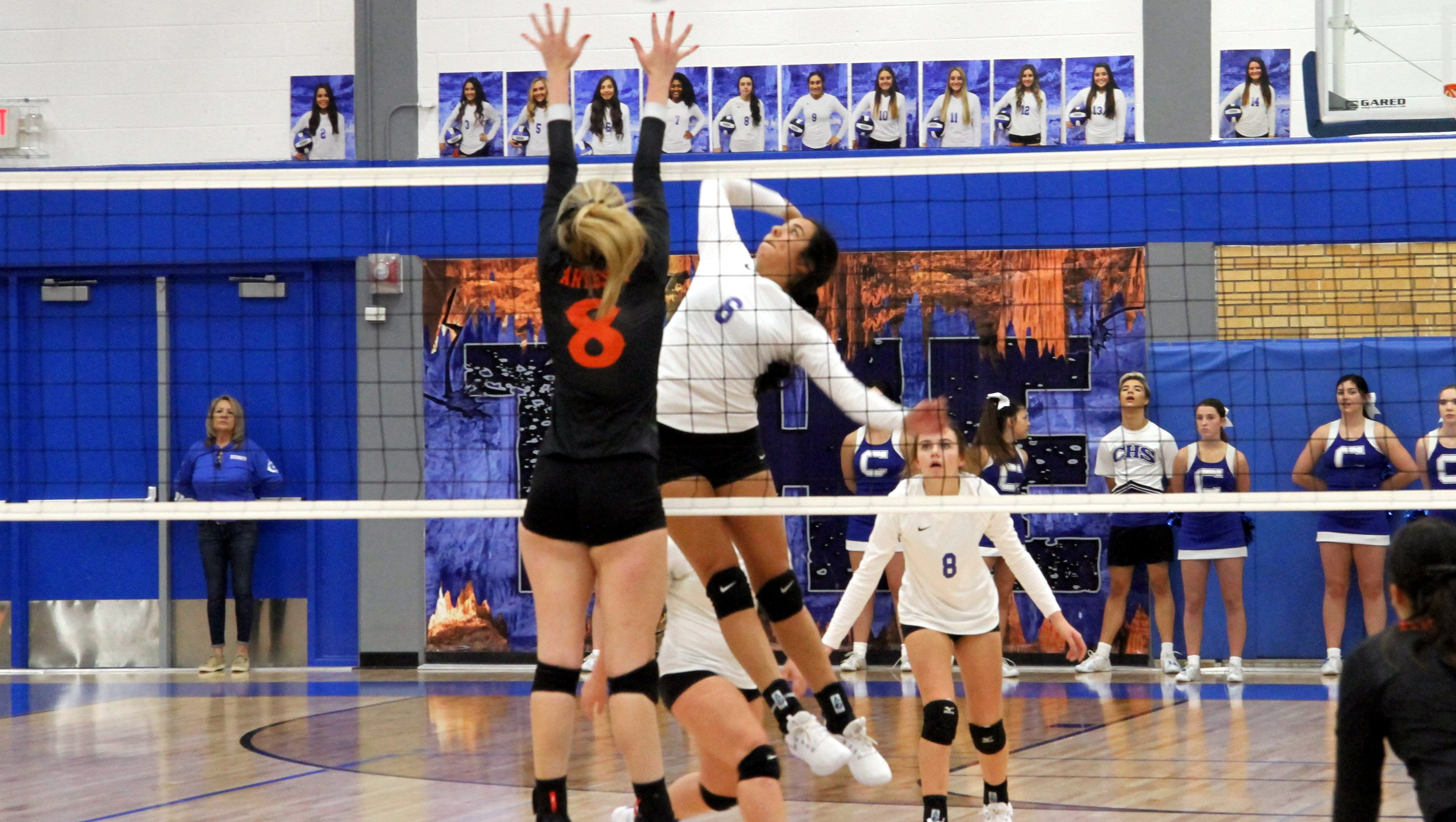 Carlsbad's Aubryanna Leos (6) goes for a spike against Artesia's Malori Mcspadden (8) during the second set of Tuesday's match. Artesia won in straight sets.