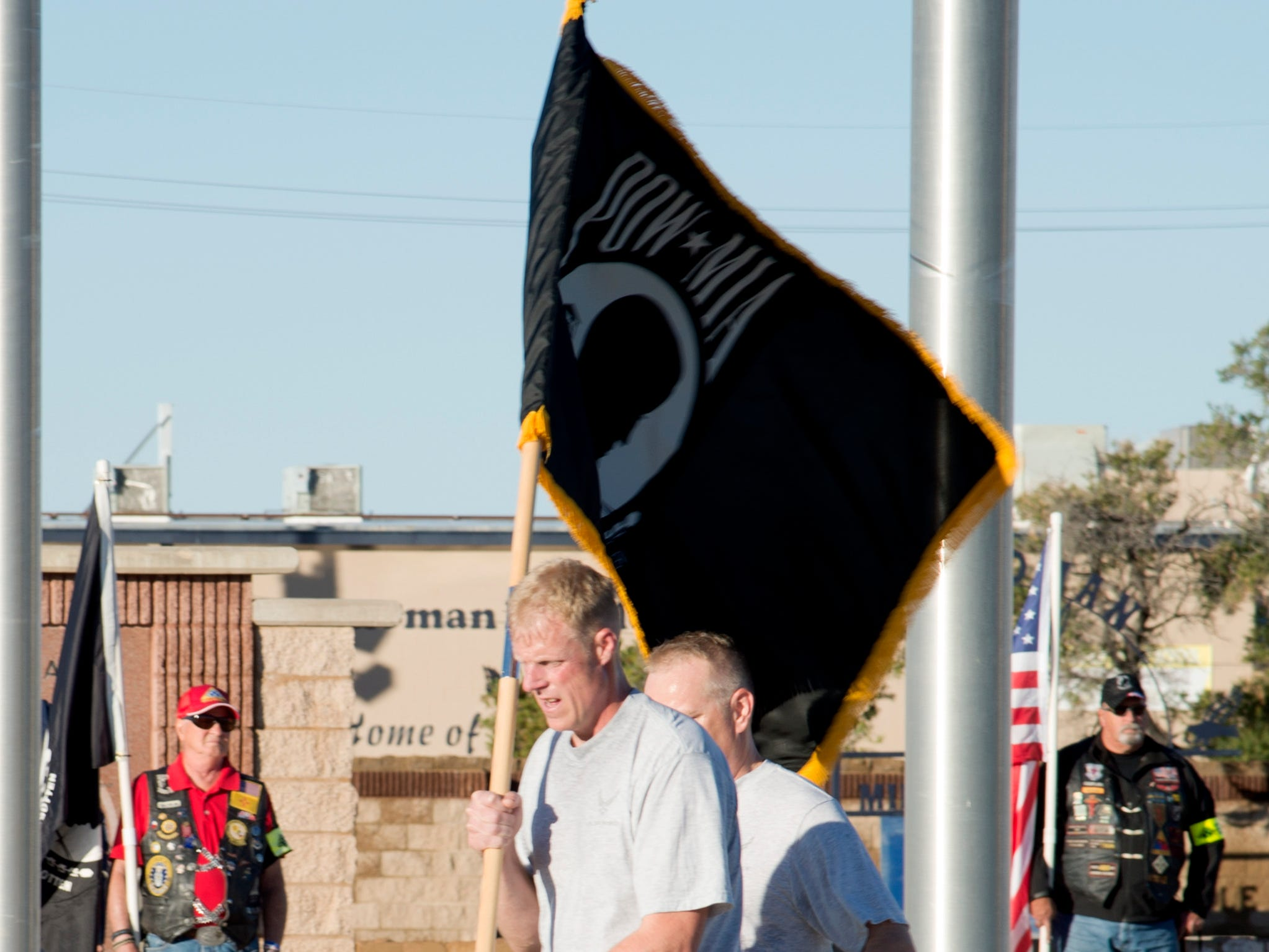 Chief Master Sgt. Timothy Wieser, 635th Material Maintenance Group Chief, runs with the POW/MIA flag during a ceremony at Heritage Park on Holloman Air Force Base, N.M., Sept. 21. The ceremony, in rememberance of prisoners-of-war and those still missing-in-action, was part of Holloman's POW/MIA commemoration.
