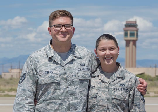 Staff Sgt. Colin Owens, 49th Wing Chapel religious affairs Airman, and Staff Sgt. Kristen Owens, 49th Operations Support Squadron air traffic controller, pose for a photo outside the air traffic control tower Aug. 23 on Holloman Air Force Base, N.M. While stationed at MacDill Air Force Base, Fla., Colin met and married his wife, Kristen, a fellow air traffic controller.