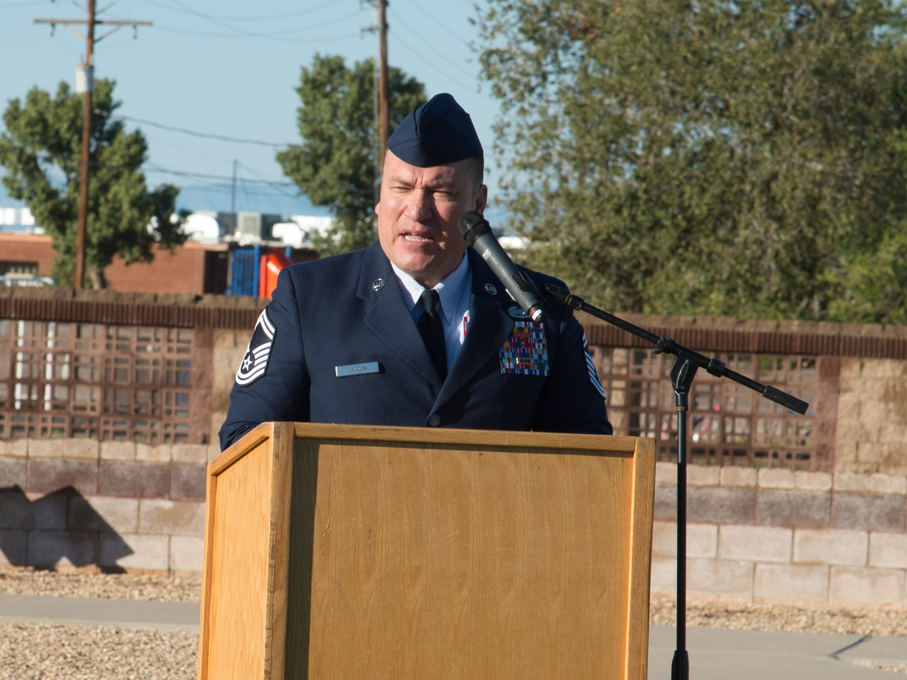 Senior Master Sgt. John Chacon, 49th Civil Engineer Squadron operations superintendent, speaks at the POW/MIA ceremony at Heritage Park on Holloman Air Force Base, N.M., Sept. 21. The ceremony, in rememberance of prisoners-of-war and those still missing-in-action, was part of Holloman's POW/MIA commemoration.