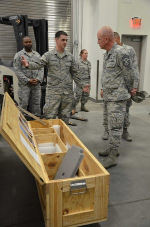 Tech. Sgt. Timothy Kavanagh, noncommissioned officer in charge of product support for the Air Force Technical Applications Center, Patrick Air Force Base, Fla., explains to Chief Master Sgt. Frank Batten, Air Combat Command command chief, how he designed a crate to better ship, house and store AFTAC's precision seismic equipment that is used to monitor worldwide nuclear activity.