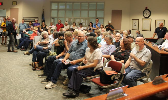 City Commission chambers were packed on Tuesday evening on account of the vote to rezone a plot of land near the Cottonwood Estates. A number of area residents spoke at the meeting against the proposed rezoning.