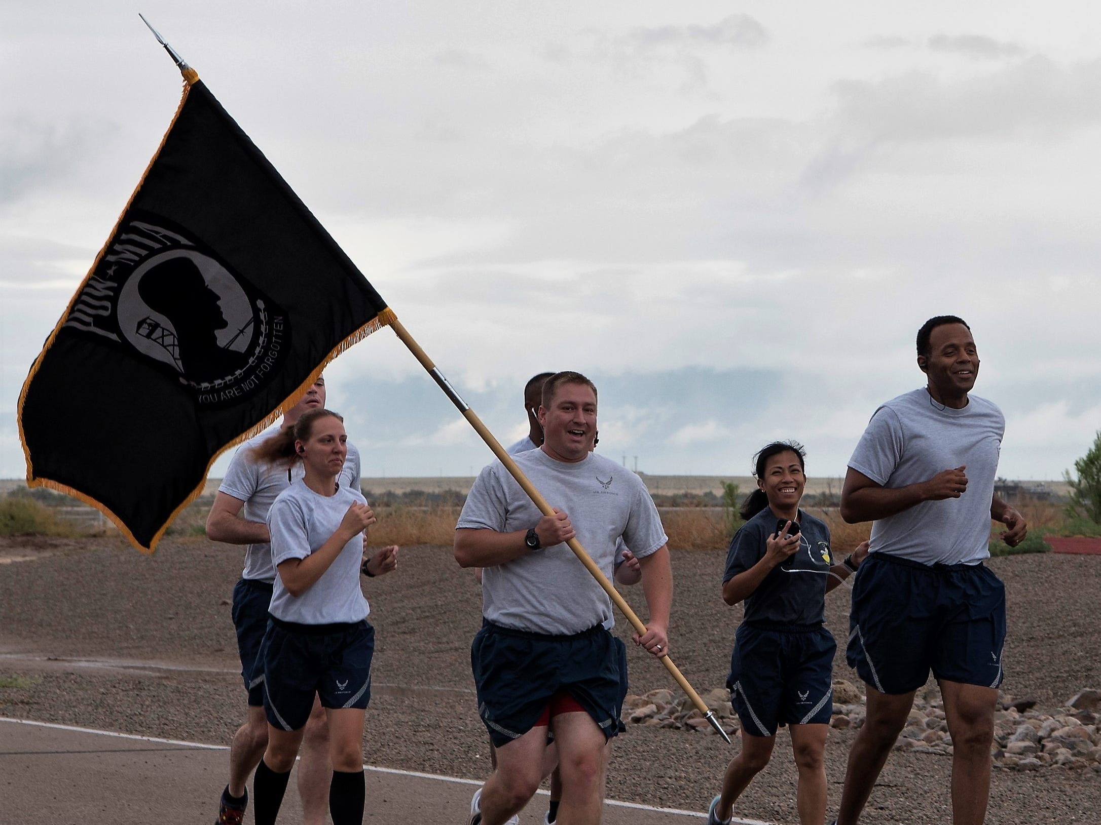 Major Steve Tatro, 49th Wing Comptroller Squadron commander, begins the Prisoner of War/Missing in Action run Sept. 20, at the base track. The Wing Staff Agency was one of the 48 groups to run for half an hour holding the POW/MIA flag.