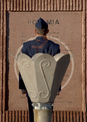 Staff Sgt. Christian Tone, an electrical systems craftsman for the 635th Material Maintenance Squadron, stands at attention in front of the POW/MIA Memorial at Heritage Park on Holloman Air Force Base, N.M., Sept. 21, as part of the 2018 POW/MIA Remembrance Day. Holloman Airmen took turns standing 24-hours straight for the vigil, honoring service members who were imprisoned and remain missing-in-action.