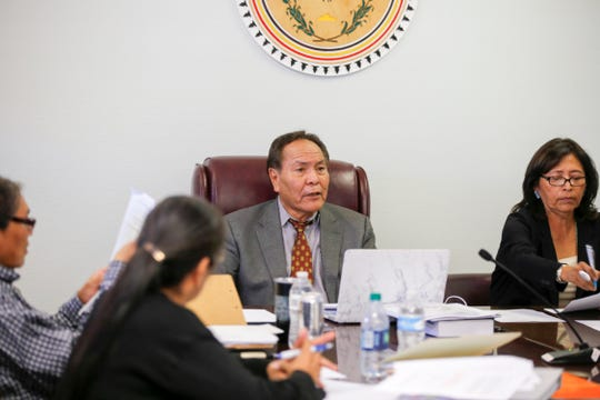 Navajo Nation Office of Hearings and Appeals Chief Hearing Officer Richie Nez, center, speaks Wednesday during a hearing at the Navajo Nation Office of Hearings and Appeals office in Window Rock, Ariz.