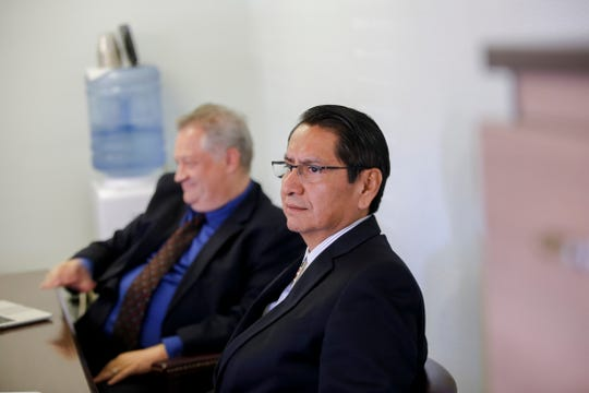 Navajo Nation presidential candidate Jonathan Nez sits with his attorney, David Jordan, Wednesday before his hearing at the Navajo Nation Office of Hearings and Appeals in Window Rock, Ariz.