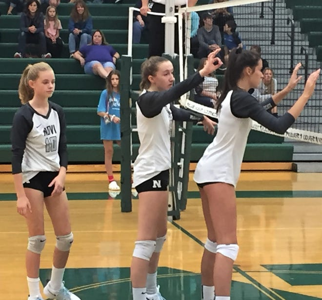 Novi volleyball trio (from left) Rachel Karr, Gaby Cummings and Caleigh Robinson patrol the front row vs. Howell.
