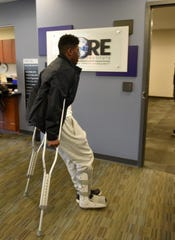 Novi senior Jason Jennings Jr., 17, arrives at the Saturday Sports Injury Clinic at the CORE Institute after suffering an ankle injury.